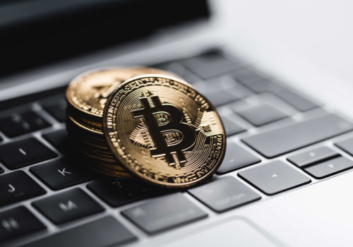 gold-bitcoin-coins-on-laptop-keyboard-picjumbo-com.jpg